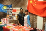 <p>Vidit Jain, ASU MBA student, and Jin Cheng, Chinese Fulbright FLTA, standing together at the Chinese country table display.</p>