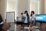 <p>Jin Cheng, Chinese FLTA, left, and Alisa Matlakhova did an interactive presentation. Jin described what was in the picture she is holding and the students had to draw what she described.</p>
