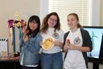 <p>Jin Cheng, Chinese FLTA, Alisa Matlakhova and Anna Klimenteva finish up the presentation.</p>