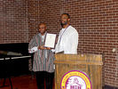 <p>Dr. Dovi Alipoe (left), director of the Office of Global Programs displaying the 2018 Multicultural Festival Proclamation with Dr. John Igwebuike, Vice Provost for Academic Affairs and Student Records.</p>