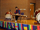 """<p>A member of the Taikoza Japanese Taiko Drum and Dance group playing a traditional Japanese stringed instrument called the """"koto.""""<br></p>"""