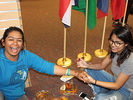 <p>Krisha Maharjan, an Alcorn student from Nepal, does henna painting on the hand of another Alcorn student.</p>