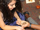 <p>Meghna Bajaj, an Alcorn student from India, paints an intricate design in henna on another student's hand.</p>