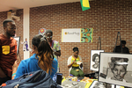 <p>Alcorn student Joseph Maxwellson (left, in maroon shirt) from Ghana is a very talented pencil artist.  Here is his display table with some examples of his amazing work.</p>