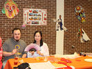 <p>Alcorn student James Wolfe and our Chinese Fulbright Foreign Language Teacher (FLTA) for 2017-2018, Jie Yuan sitting at the China table enjoying some of the international food.</p>