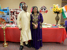<p>Dr. Girish and Rani Panicker, Alcorn faculty and staff members, respectively, stand in front of their India display table wearing traditional Indian outfits.</p>