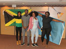 <p>Alcorn students showing off the flags of their countries, Jamaica and Saint Lucia.</p>